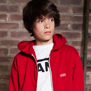 Model in red Vans hoodie