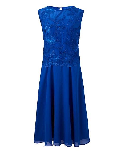 3e842e95cc24 Nightingales Overlay Dress. Click to view  Nightingales  products. Rollover  image to magnify