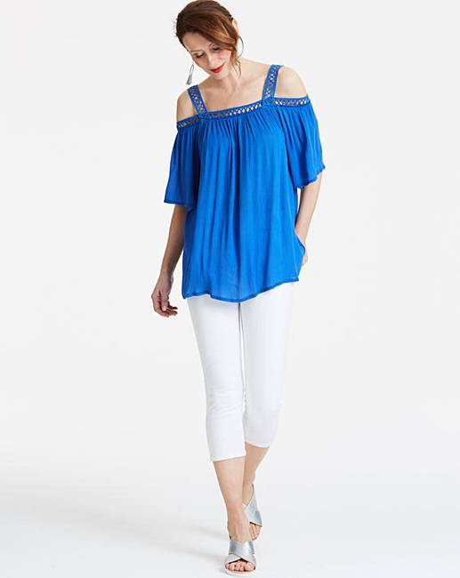 659e58f4158ee Blue Crochet Trim Cold Shoulder Top. Rollover image to magnify