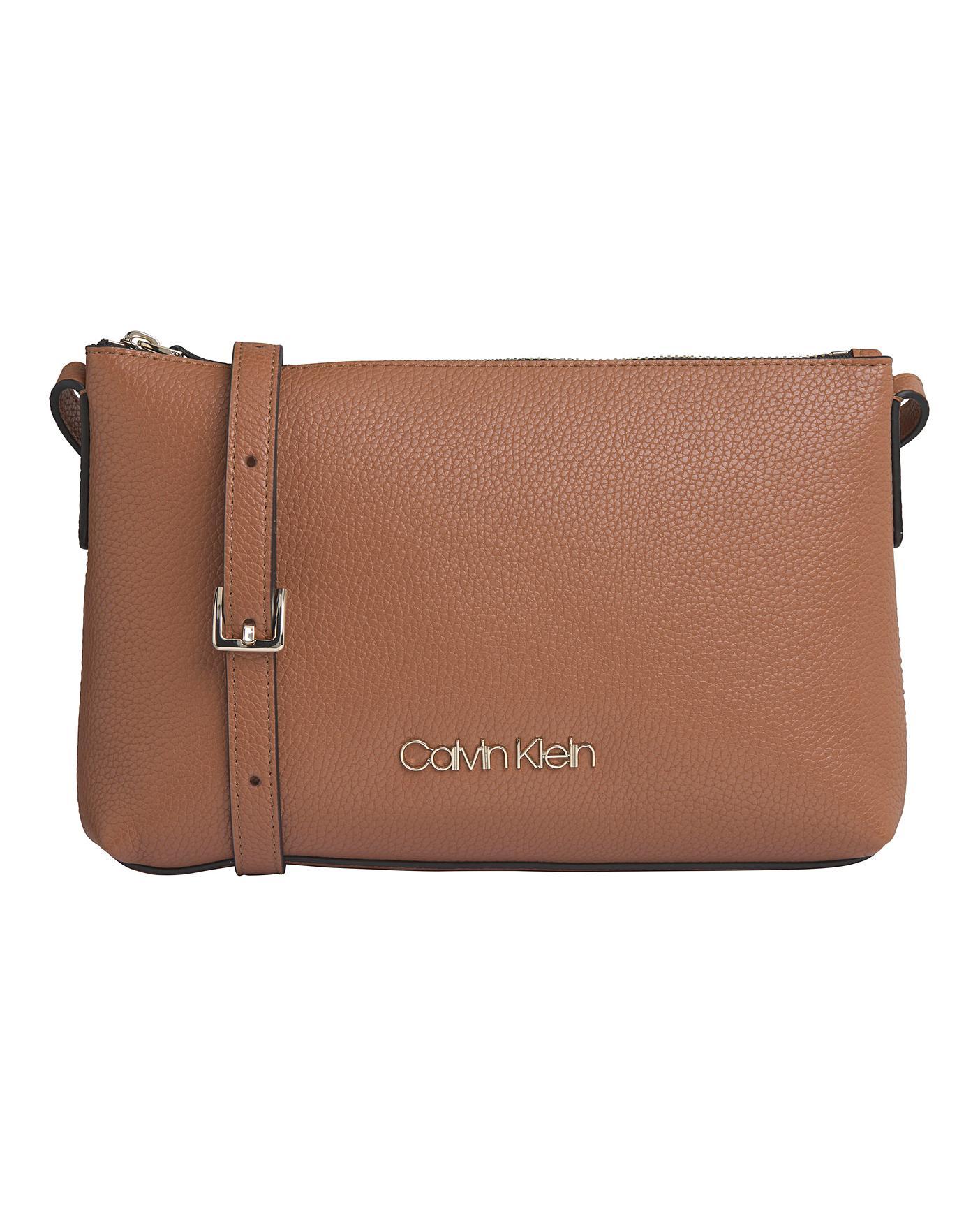 på fötter skott av bra ut x professionell försäljning Calvin Klein Neat Crossbody Bag Tan   Home Essentials