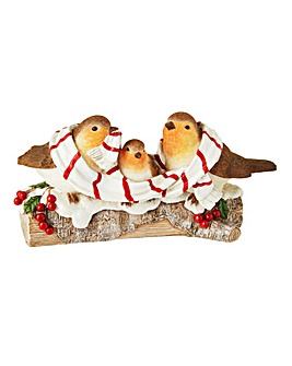Robin Family Perched on a Log