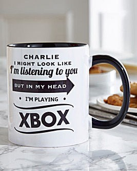 Personalised 'I Might Look Like I'm Listening' Mug