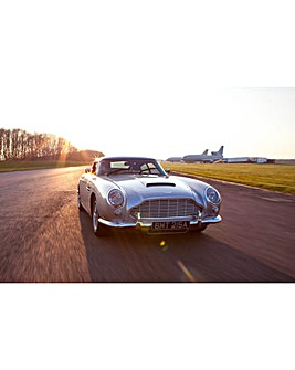 Iconic Aston Martin DB5 Driving Blast