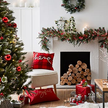 Lounge and fireplace with Christmas decorations