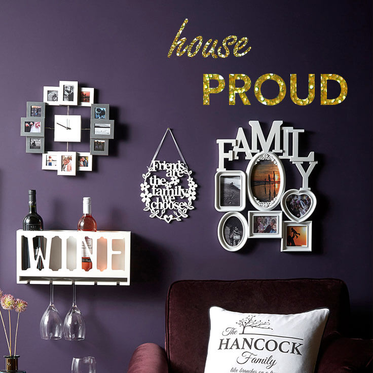home decorations on purple wall; text - house proud