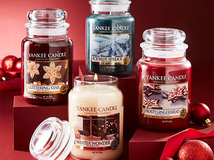 collection of yankee candles on red background