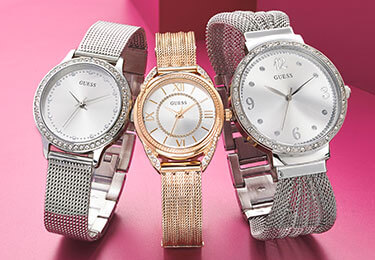3 lady wristwatches on pink background