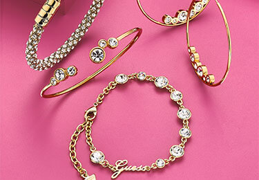 collection of jewellery on pink background