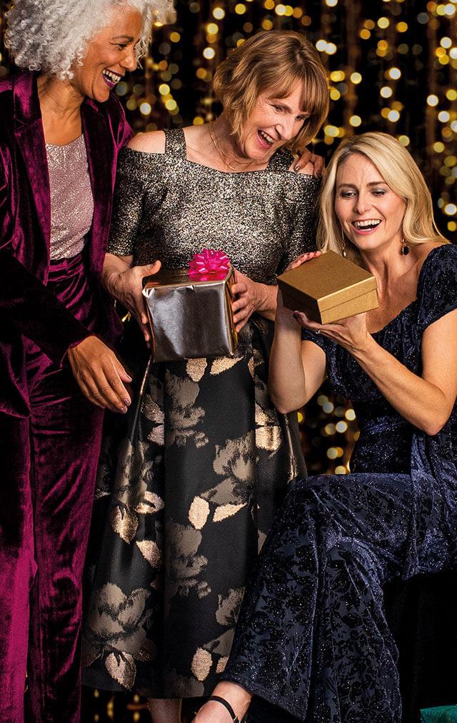 women opening gifts