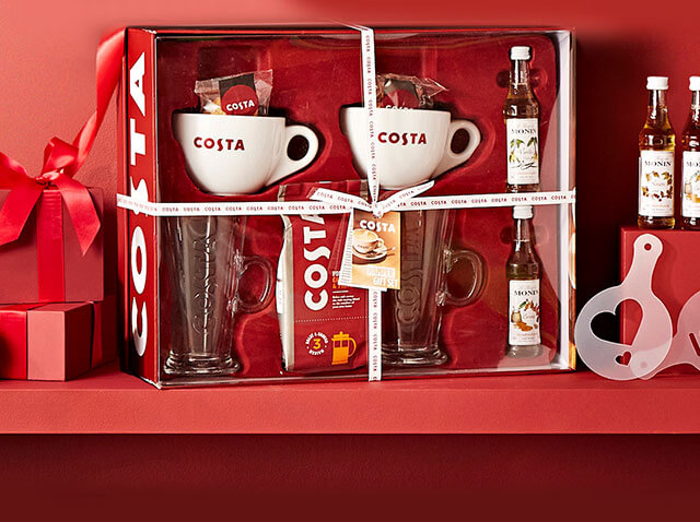 collection of coffee and treats on red background